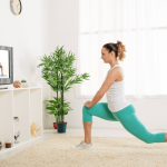 A female doing a yoga class from the comfort of her home led by a female personal trainer online